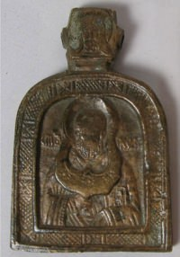Small Russian pectoral brass plaquette icon depicting Saint Nicholas of Myra